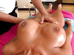 Horny Angelina Valentine has her boobs rubbed with oil