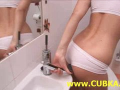 Charming blonde dildoing in toilet