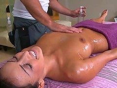 Tanned brunette Breanne Benson gets her body oiled and professionally massage by sexy guy