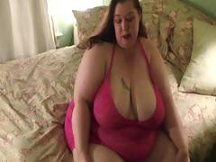 Very large women strips down to her panyhose and then shows large ass