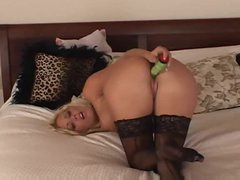 Girl with a green vibrator plays with pussy