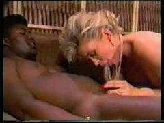 Two black guys fuck white slut in classic video